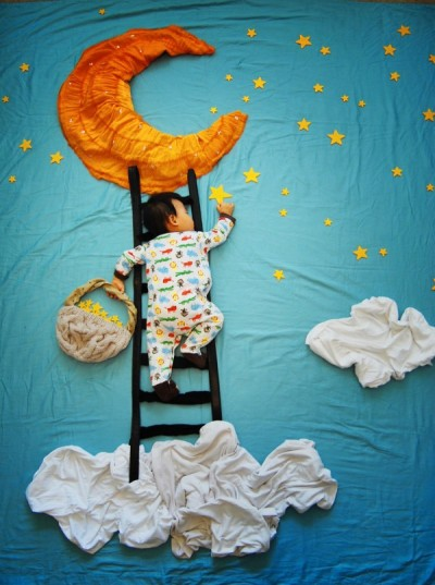baby-reaches-for-the-stars-600x805